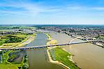 Nederland, Gelderland, Nijmegen, 09-06-2016; de nieuw aangelegde nevengeul van de rivier de Waal, ontstaan door de dijkverlegging bij Lent. Onderdeel van het project Ruimte voor de River (Ruimte voor de Waal). In de voorgrond de nieuwe stadsbrug van Nijmegen over rivier de Waal, De Oversteek. <br /> The finished dike relocation of Lent (project Ruimte voor de Rivier: Room for the River) with the resulting flood trench. In the foreground the new city bridge of Nijmegen on the river Waal, De Oversteek (The Crossing).<br /> luchtfoto (toeslag op standard tarieven);<br /> aerial photo (additional fee required);<br /> copyright foto/photo Siebe Swart