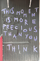 Sign on a wall &quot;This Moment Is More Precious Than You Think&quot;