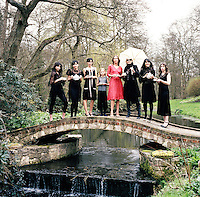 From left: Daisy Lowe, Pearl Lowe, Zoë Grace, Ella Richards, Lucie de la Falaise, Anita Pallenberg, Lisa Moorish and Sarah Leon, all dressed in Lowe's line of lace dresses on the grounds of her estate in Hampshire