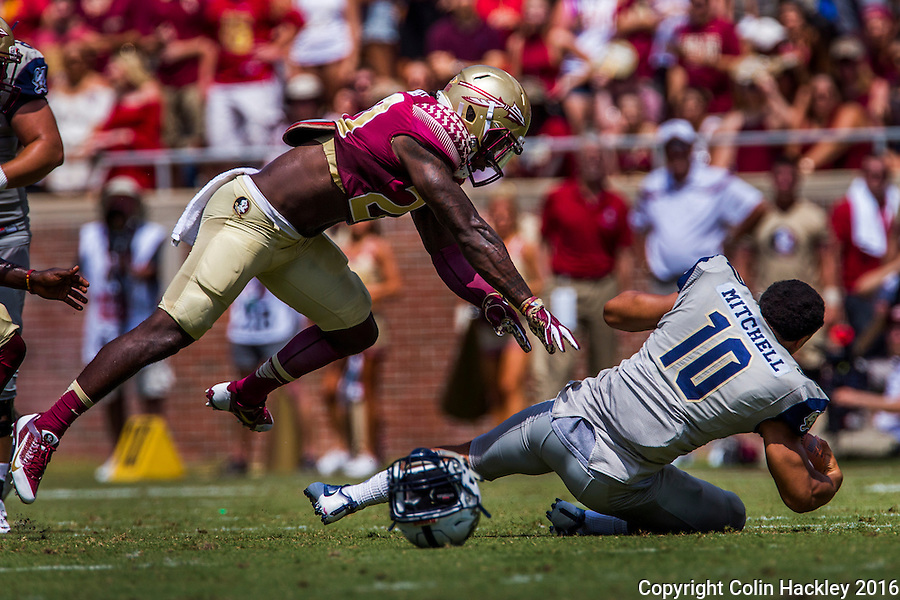 TALLAHASSEE, FLA 9/10/16-Florida State defensive back Trey Marshall pushes Charleston Southern quarterback Robert Mitchell to the ground for a five yard loss during first quarter action Saturday at Doak Campbell Stadium in Tallahassee. <br /> COLIN HACKLEY PHOTO