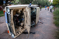 A truck belonging to copper cable thieves sits overturned on one of Durban Deep's roads on the outskirts of Johannesburg, South Africa, after local residents, frustrated with the ongoing attacks on their neighborhood and with no response from police despite many calls, formed a vigilante group to tackle the situation themselves. Apparently the thieves had abandoned the truck and run off. This was just the first of many incidents that ultimately led to the murder of six men by the local vigilante group.