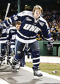 Greg Burke (UNH - 26) - The University of Maine Black Bears defeated the University of New Hampshire Wildcats 5-4 in overtime on Saturday, January 7, 2012, at Fenway Park in Boston, Massachusetts.