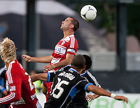 Santa Clara, California - Saturday July 18, 2012: FC Dallas' Andrew Jacobson jumps for the ball during a game against San Jose Earthquakes at Buck Shaw Stadium, Stanford, Ca   San Jose Earthquakes defeated FC Dallas 2 - 1.