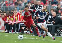 14 April 2012: Toronto FC midfielder Luis Silva #11 and Chivas USA midfielder Ryan Smith #22 in action during a game between Chivas USA and Toronto FC at BMO Field in Toronto..Chivas USA won 1-0.