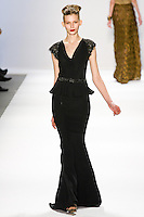 Monika Sawicka walks the runway in a Luca Luca Fall 2011 outfit, designed by Raul Melgoza, during Mercedez-Benz Fashion Week, February 10, 2011