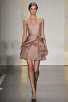 Model walks runway in a taupe mikado organza a-line dress, strapless sweetheart neckline, natural waist, pickup skirt bridesmaid dress by Lazaro Perez, from the Noir by Lazaro Spring 2012 Bridal fashion show.