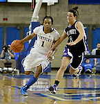 A'dia Mathies brings the ball up the court with High Point junior Tayler Tremblay battling her all the way at the Women's Basketball game at Memorial Coliseum in Lexington, Ky., on Saturday, November. 17, 2012..