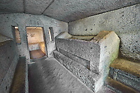 Interior of an Etruscan burial tomb known  with sarcopoghi carved out of the volcanic tuff rock, 6th century BC, Necropoli della Banditaccia, Cerveteri, Italy. A UNESCO World Heritage Site