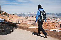Female walking along Rim trail, Bryce Canyon national park, Utah, USA
