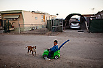 A three-year-old boy plays in the Rancho Garcia trailer park in Thermal, Calif., March 9, 2012.