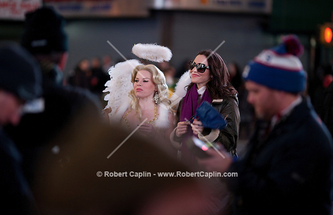 Actresses and singers Megan Hilty and Katherine McPhee on the set of NBC's new show SMASH  in Times Square in New York. Dec 9, 2011...Photo by Robert Caplin.