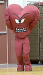 WATERBURY, CT- 02 JAN 2008- 020508JT24-<br /> The mascot for Sacred Heart High School, the Heart, cheers on its boys basketball team during a game against Holy Cross on Jan. 2, 2008.<br /> Josalee Thrift / Republican-American