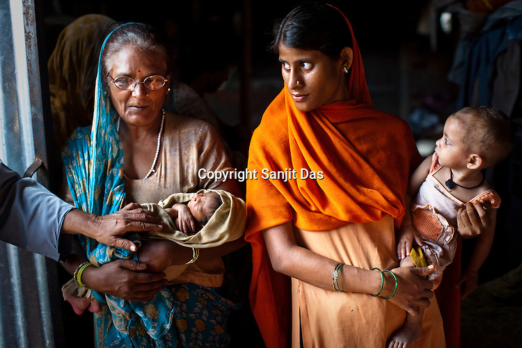 Local villagers get the infants vaccinated during the routine immunization drive in Loharpatti Village, in Bettiah of East Champaran district in Bihar. Since 2008 the Foundation and Geneva Global have been investing in the training of medical staff to improve the lives of people living in 600+ villages in the region. The NGOs are delivering cost effective interventions to address treatment, care and prevention of diseases, disability and preventable deaths amongst infants, adolescent girls and women of child-bearing age. There is statistical and anecdotal evidence that there have been vast improvements and a total of 40-50% increased immunization for all children under 6 has meant that communities can be serviced and educated long term. Photograph: Sanjit Das/Panos for Legatum Foundation