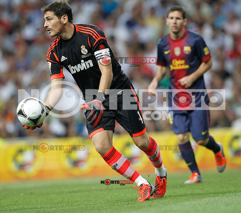 Real Madrid's Iker Casillas and F.C. Barcelona's Lionel Messi during Spanish Supercup 2nd match on august 29 2012...Photo: Cesar Cebolla / ALFAQUI /NortePhoto.com<br />