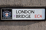 london bridge sign on stone wall