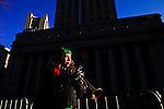 A woman plays a trumpet while Immigrants Protest during the International Migrants Day as they receive support by Occupy Wall Street members in New York, United States. 18/12/2011.  Photo by Eduardo Munoz Alvarez / VIEWpress.