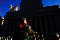 A woman plays a trumpet while Immigrants Protest during the International Migrants Day‎ as they receive support by Occupy Wall Street members in New York, United States. 18/12/2011.  Photo by Eduardo Munoz Alvarez / VIEWpress.