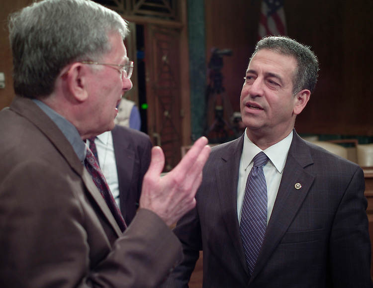 """01/30/07--Sen. Russ Feingold, D-Wis., talks with witness Louis Fisher, left, a constitutional law expert with the Library of Congress after chairing a Senate Judiciary hearing titled """"Exercising Congress' Constitutional Power to End a War."""" Other witnesses were: David J. Barron, a professor at Harvard Law School; Bradford Berenson, Sidley Austin partner; Walter Dellinger, a professor at Duke University School of law and former acting U.S. solicitor general;; and Robert F. Turner, associate director of the Center for National Security Law at the University of Virginia School of Law..Congressional Quarterly Photo by Scott J. Ferrell"""