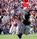 Oakland Raiders vs. Denver Broncos at Oakland Alameda County Coliseum Sunday, September 20, 1998.  Broncos beat Raiders  34-17.  Oakland Raiders defensive back Charles Woodson (24) knock out ball intended for Denver Broncos wide receiver Ed McCaffrey (87).