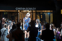 Shoppers at the Cynthia Rowley boutique on Bleecker Street in the West Village in New York on Friday, September 10, 2010 can pose with a real live fashion model during the second annual Fashion's Night Out event. On the first evening of New York Fashion Week stores around the city offered sales and bargains as well as parties and events to entice customers to shop. The event has been so successful in boosting sales that this year over 100 cities in the US are having their own events, and Fashion's Night Out is being planned for 16 countries. (© Richard B. Levine)