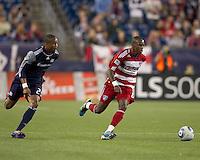 FC Dallas midfielder Jackson Goncalves (6) dribbles as New England Revolution defender Darrius Barnes (25) closes. In a Major League Soccer (MLS) match, the New England Revolution defeated FC Dallas, 2-0, at Gillette Stadium on September 10, 2011.