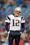 New England Patriots quarterback Tom Brady smiles during a time-out against the Buffalo Bills at Ralph Wilson Stadium in Orchard Park, NY, on December 11, 2005 . The Patriots defeated the Bills 35-7. Mandatory Photo Credit: Ed Wolfstein