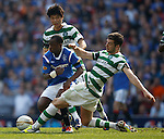 Sone Aluko skips past Charlie Mul;grew and Ki