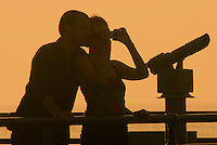 A couple snap a shot amid the sunset from the Santa Monica Pier on Friday, September 9, 2011.