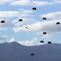 Members of the French Foreign Legion jump over the airport of Tarbes, France, during a full scale multi-force exercise, 11 December 2007.