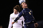 24 November 2013: Navy's Patrick Sopko (6) heads the ball over Wake Forest's Hunter Bandy (20). The Wake Forest University Demon Deacons played the Naval Academy Midshipmen at Spry Stadium in Winston-Salem, NC in a 2013 NCAA Division I Men's Soccer Tournament Second Round match. Wake Forest won the game 2-1.