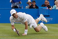 JUN 17 Andy Murray falls during tennis match