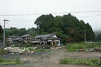Landscape view of damaged buildings following the 311 Tohoku Tsunami in Aikawa, Japan  © LAN