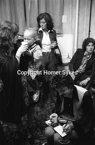 "Paul and Linda McCartney Wings Tour  1975. Paul signing autographs Denny Laine wife JoJo Laine feeds their baby a drink. Manchester. England. The photographs from this set were taken in 1975. I was on tour with them for a children's ""Fact Book"". This book was called, The Facts about a Pop Group Featuring Wings. Introduced by Paul McCartney, published by G.Whizzard. They had recently recorded albums, Wildlife, Red Rose Speedway, Band on the Run and Venus and Mars. I believe it was the English leg of Wings Over the World tour. But as I recall they were promoting,  Band on the Run and Venus and Mars in particular."