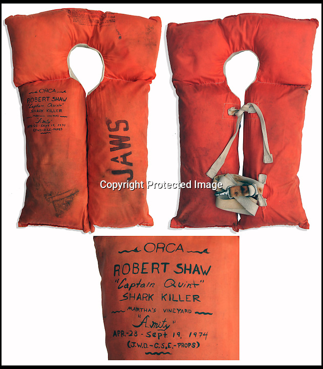 BNPS.co.uk (01202 558833)<br /> Pic: NateDSaunders/BNPS<br /> <br /> ***Please use full byline***<br /> <br /> Actor Robert Shaw's life jacket. <br /> <br /> Rare behind-the-scenes photographs taken on the set of the cult movie 'Jaws' has surfaced after 40 years.<br /> <br /> The 75 pictures include ones of star Roy Scheider, who played shark-hunting police chief Brody in the classic 1975 film, and director Steven Spielberg.<br /> <br /> There are several snaps of the giant mechanical rubber shark that wreaked terror on the fictional seaside resort of Amity.<br /> <br /> It is depicted being hoisted in the air and moved into position as well as sat in a dry dock during a break in the filming.