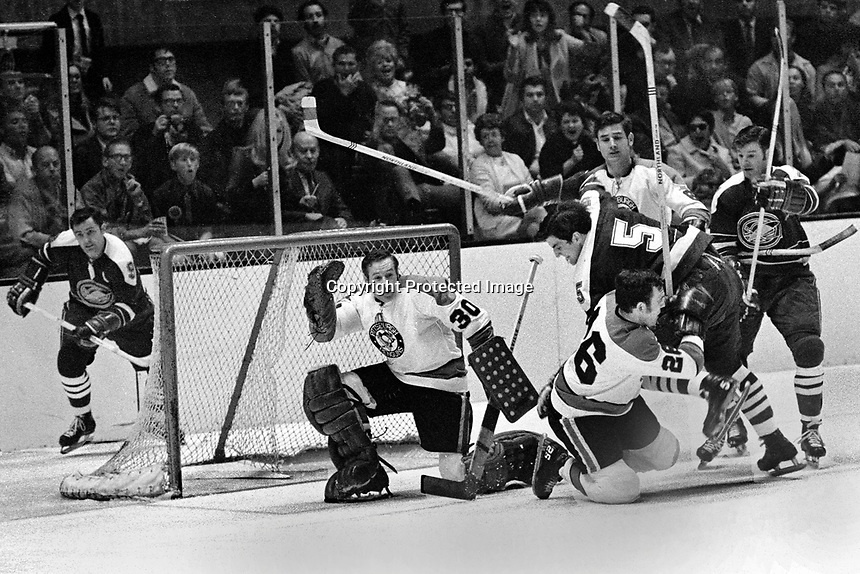 Seals vs Pittsburg April 12,1970: Seals Bill Hicke, Carol Vadnais, Earl Ingarfield. Penguins goalie Les Binkley and Dunc McCallum and Tracy Pratt defend..(photo/Ron Riesterer)