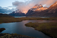 The Cuernos del Paine, or Paine Horns, peak from the mist over Lago Nordenskjold (umlaut on second o) at Torres del Paine National Park in southern Chile. (Kevin Moloney for the New York Times)