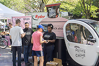 "Stonyfield Dairy gives away samples of their ""Petite Creme"" low fat yogurt after the Susan G. Komen Race for the Cure on the Central Park Mall at the ""sponsor village"" on Sunday, September 7, 2014. (© Richard B. Levine)"