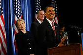 Chicago, IL - December 1, 2008 -- United States President-Elect Barack Obama gives a press conference to introduce nominees United States Senator Hillary Rodham Clinton (Democrat of New York), left, for Secretary of State, and retired Marine General James L. Jones, middle, as national security adviser Monday morning, December 1, 2008 at the Chicago Hilton & Towers in Chicago, Illinois.  Obama also introduced Washington Lawyer Eric Holder, for Attorney General, and Arizona Gov. Janet Napolitano, for homeland security secretary, and Susan Rice as United Nations ambassador. Obama said he would keep defense secretary Robert Gates in his current post..Credit: Anne Ryan - Pool via CNP