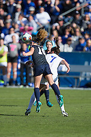 Cary, North Carolina - Sunday December 6, 2015: Emily Ogle (10) of the Penn State Nittany Lions heads the ball away from Taylor Racioppi (7) of the Duke Blue Devils during first half action at the 2015 NCAA Women's College Cup at WakeMed Soccer Park.  The Nittany Lions defeated the Blue Devils 1-0.