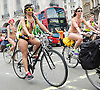 Naked Bike Ride<br /> Protest through Central London, Great Britain<br /> 14th June 2014<br /> Protestors ride their bikes naked through the streets of London<br /> The World Naked Bike Ride (WNBR) is an international clothing-optional bike ride in which participants plan, meet and ride together en masse on human-powered transport (the vast majority on bicycles, but some on skateboards and inline skates), to &quot;deliver a vision of a cleaner, safer, body-positive world.<br /> <br /> Photograph by Elliott Franks