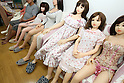 July 5, 2010 - Tokyo Japan - Ta-bo, an avid Love Doll collector, sits in a room with many Love Dolls from hi collection Tokyo, Japan, on July 5, 2010. The 50-year-old Japanese engineer who rents a special three-bedroom apartment for his Love Dolls, says he owns more than one hundred, which is, to his mind, the world's largest collection of its kind.