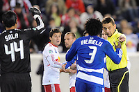 Referee Alex Prus points to the penalty spot after Sinisa Ubiparipovic (8) of the New York Red Bulls was fouled in the penaalty area. The New York Red Bulls defeated FC Dallas 2-1 during a Major League Soccer (MLS) match at Red Bull Arena in Harrison, NJ, on April 17, 2010.