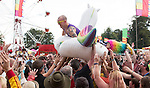 Electric Fields music festival at Drumlanrig Castle, Dumfries and Gallloway Scotland. Colonel Mustard crowd surfing in a blow up unicorn