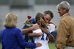 Duke's Jenny Alleva (17) gets a hug from head coach Robbie Upchurch as her parents, Joe Alleva (r), Duke's Athletic Director, and Annie Alleva (l) stand by during Senior Day on Sunday, October 22nd, 2006 at Koskinen Stadium in Durham, North Carolina. The Duke Blue Devils defeated the Florida State University Seminoles 3-1 in an Atlantic Coast Conference NCAA Division I Women's Soccer game.