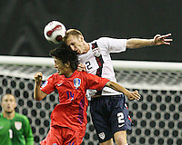 Tim Ward wins a header from Chung Yong Lee. Republic of Korea and the USA tied 1-1 at the FIFA U20 World Cup at the Olympic stadium in Montreal, Canada on June 30, 2007.