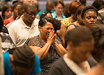 BATON ROUGE, LA -JULY 07:  Minister Deborah Harris prays during a prayer vigil for Alton Sterling at the Living Faith Christian Center in Baton Rouge, Louisiana July 7, 2016.  Sterling was shot and killed by police on July 5, 2016 in Baton Rouge, Louisiana. (Photo by Mark Wallheiser/Getty Images)