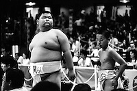 Two Young Rikishi Sumo competitors wait for their contest..450 children, aged between 11-14, qualified for  the All Japan Wanpaku Sumo Tournament. The  Ryogoku Kokugikan Stadium, Tokyo, Japan.