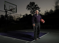NWA Democrat-Gazette/ANDY SHUPE<br /> The home of Steve Clark, president of the Fayetteville Chamber of Commerce, includes an outdoor basketball court featuring Fayetteville High School purple colors. Wednesday, Nov. 4, 2015.