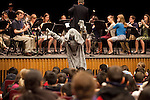 Jumbo makes an appearance during a performance for Somerville schoolchildren by the Tufts University Wind Ensemble at Cohen Auditorium on Jan. 10, 2012. (Kelvin Ma/Tufts University)