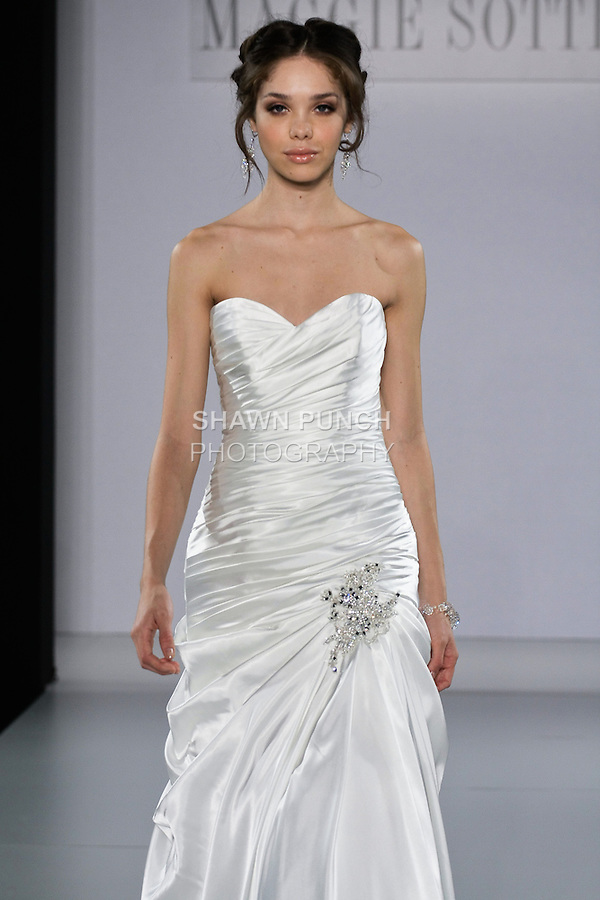 Model walks runway in a Tara wedding dress from the Maggie Sottero Spring 2013 collection, at The Couture Show, during New York Bridal Fashion Week, on October 14, 2012.
